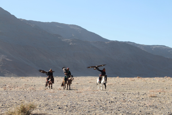 eagle hunters riding horse