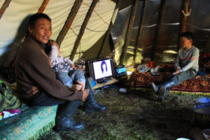reindeer herder family in the teepee